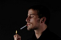 Man lighting a cigarette, portrait
