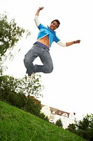 A boy jumping in a park