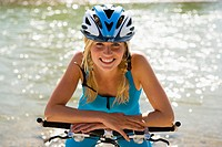 A woman wearing a cycling helmet