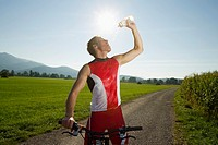 A cyclist drinking water