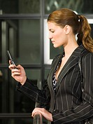 A business woman using her mobilephone
