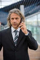 A businessman talking on his cell phone