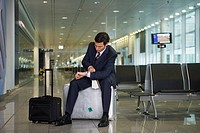 A businessman waiting in the departure lounge