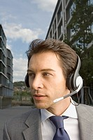 A businessman wearing a headset