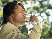 Man drinking white wine (thumbnail)