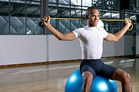 Man sitting on a fitness ball