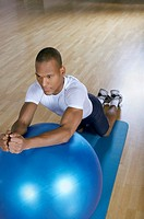 Man stretching on a fitness ball