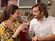 Close-up of a mid adult couple toasting with wine glasses