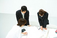 Businessmen and Businesswoman In Meeting, High Angle View