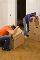 Couple looking into cardboard boxes