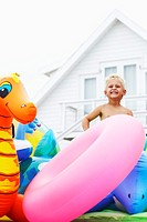 Boy with Pool Toys