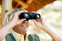 Senior Man Using Binoculars