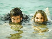 Portrait of a young couple swimming in water (thumbnail)