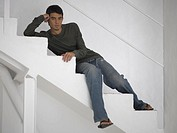 Portrait of a young man lying on a staircase (thumbnail)