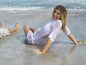 Woman reclining on the beach