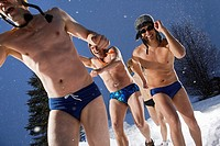 Friends Wearing Swim Suits in Snow