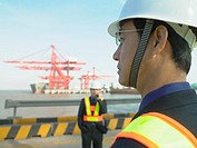 Men at container terminal