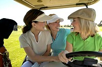 Women driving golf cart