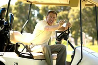 Man driving golf cart