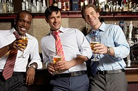 Businessmen having drinks in bar