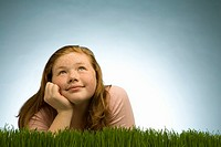 Girl thinking in grass