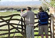 Birdwatchers watching birds in S'Albufera, Majorca, Spain