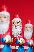 Santa Claus chocolates in a row