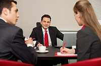 Three businesspeople having a meeting