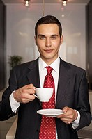 Businessman drinking a cup of coffee, portrait