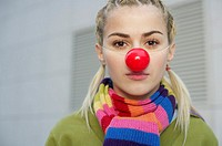 Young woman wearing red nose
