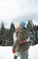 Couple embracing each other in snow
