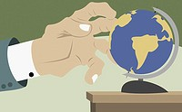 Businessman´s hand touching a globe
