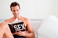Man reading a book about sex (thumbnail)