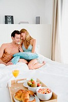 Intimate couple with breakfast in bed