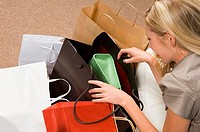 Woman looking in shopping bags