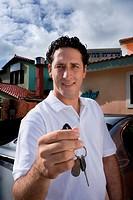 Valet parker holding car keys