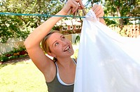 Young woman hanging laundry, Regina, Saskatchewan