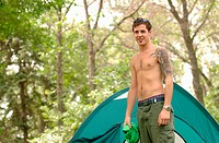 Young man w/tattoo in front of tent, Regina, Saskatchewan