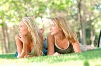 2 young blonde females in park, Regina, Saskatchewan