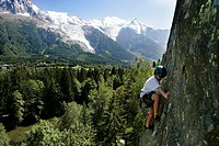Young kid climbing in front of Mont Blanc, Les Gaillands, Chamonix