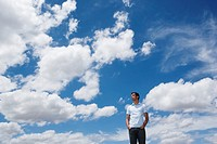 Man looking at the clouds and sky