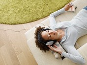 Woman relaxing wearing headphones