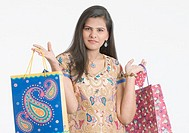 Portrait of a teenage girl holding shopping bags