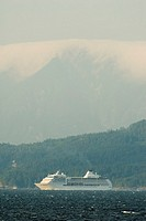 A Cruise ship passing below a large mountain, Canada, British Columbia, Nanaimo
