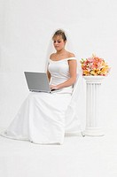 Bride using laptop