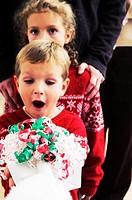 Boy getting a gift from Santa