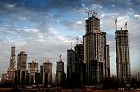 Business Bay Executive Towers Construction with Burj Dubai in the background, Dubai, UAE