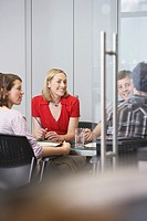 Office workers sitting around conference table