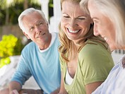 Three people sitting on verandah (thumbnail)