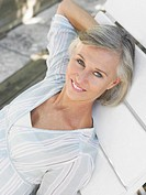 Woman reclining on sun lounger elevated view portrait